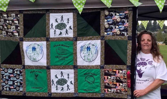 A handmade quilt from our event shirts at the 2017 Walk, Run, and Roll for Thought